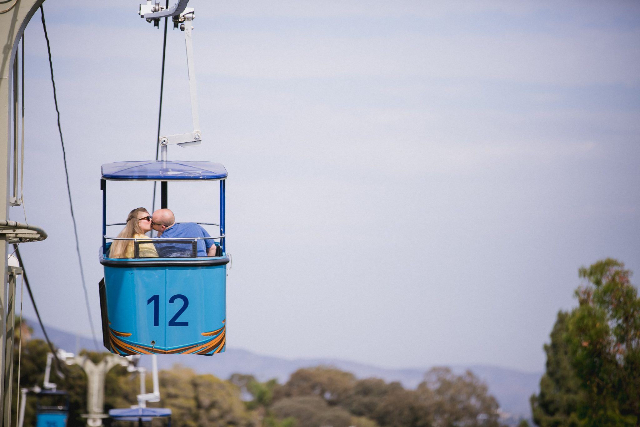 Zoo engagement photos in the aerial tram in San Diego