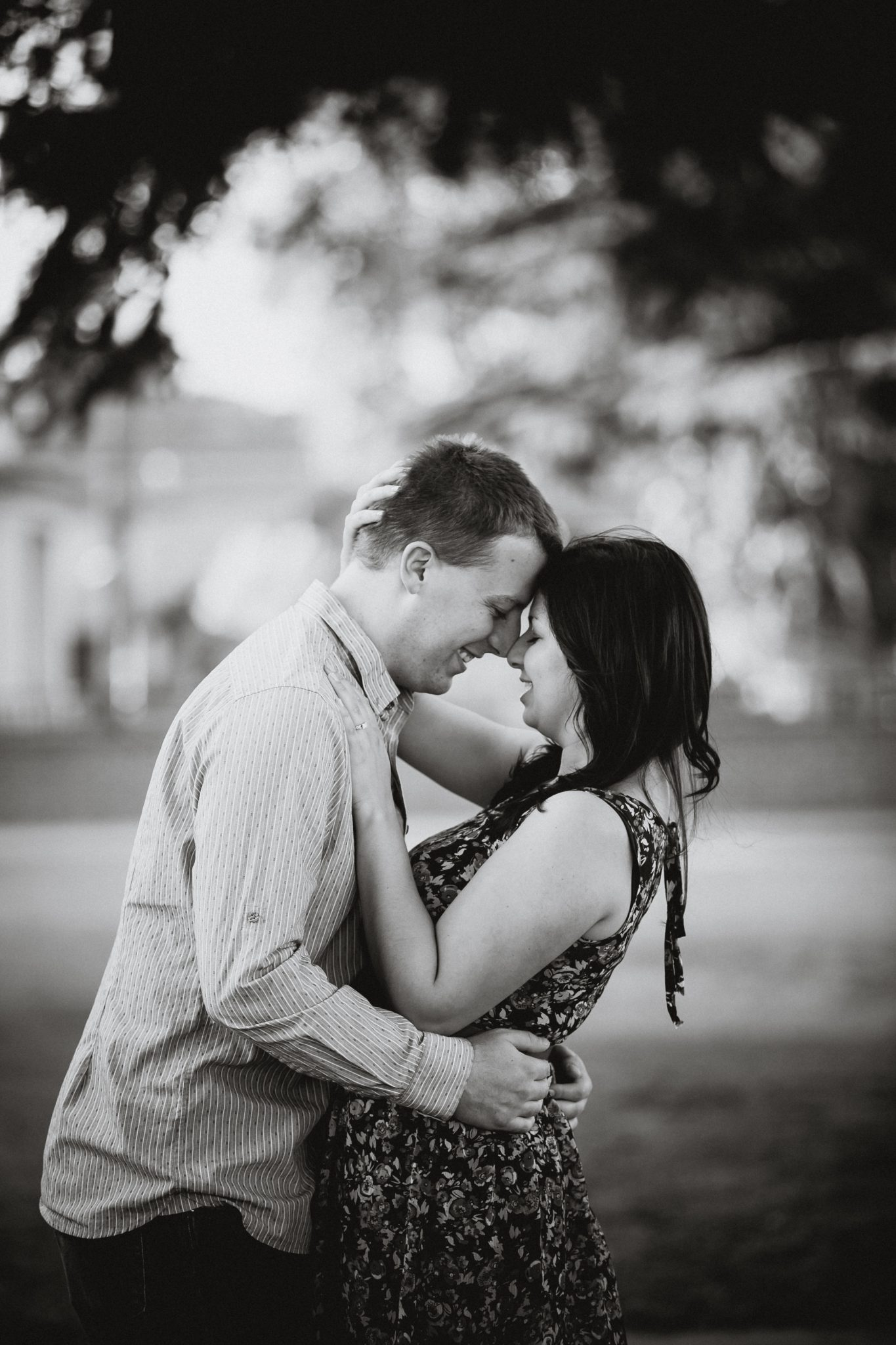 Black and white posed photo during an engagement shoot