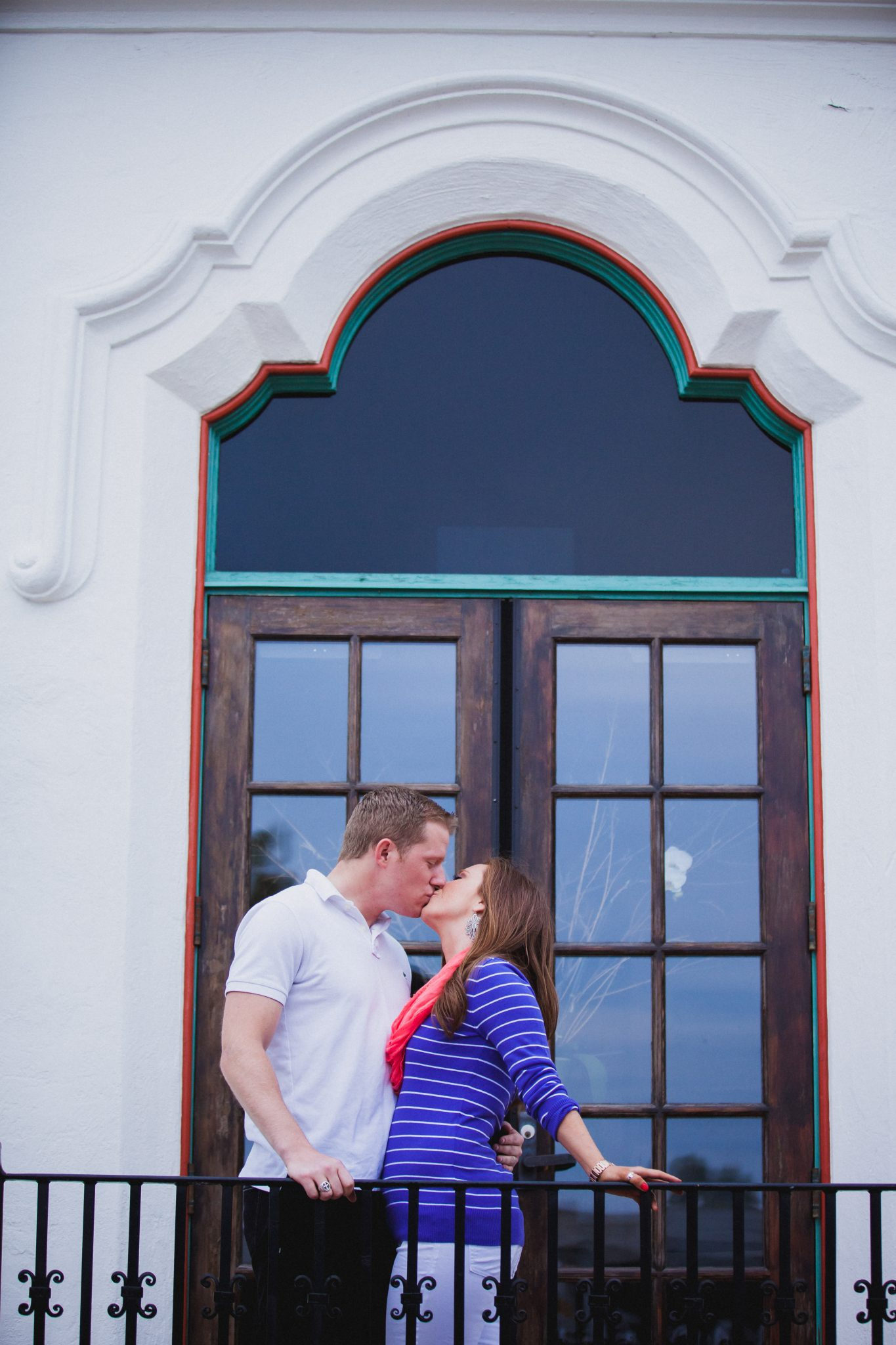 Engagement photo at Balboa Park with the couple kissing