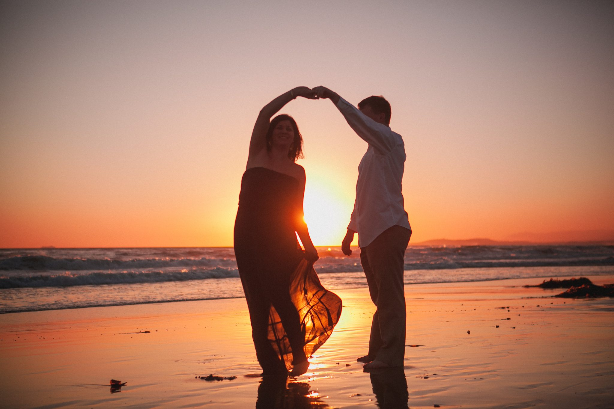 Romantic sunset engagement photo at the beach