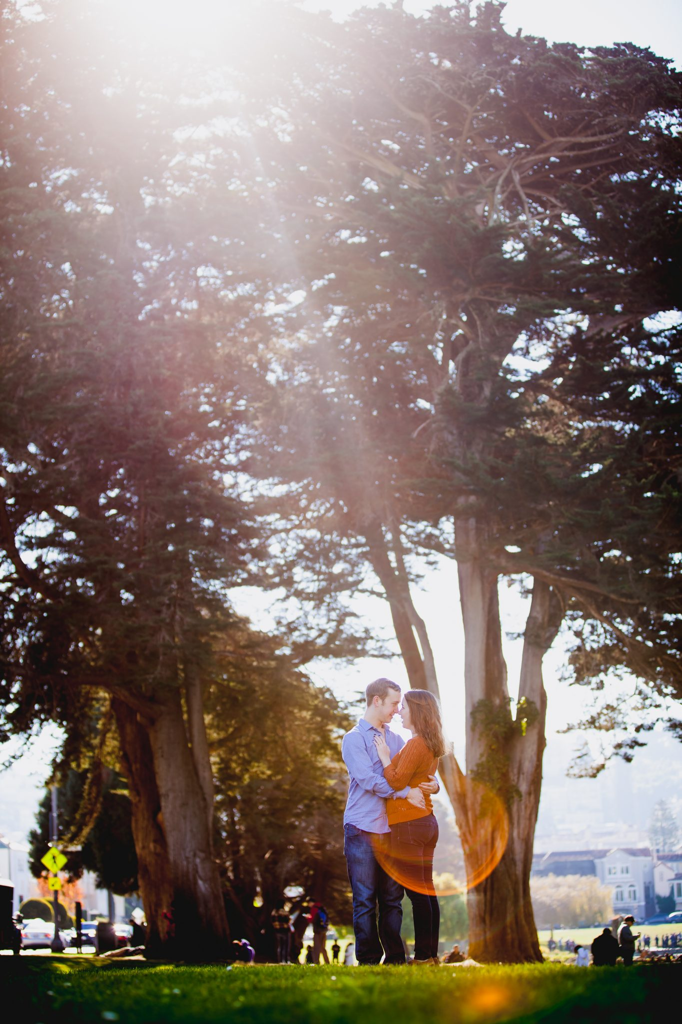 Park engagement session with a sunflare