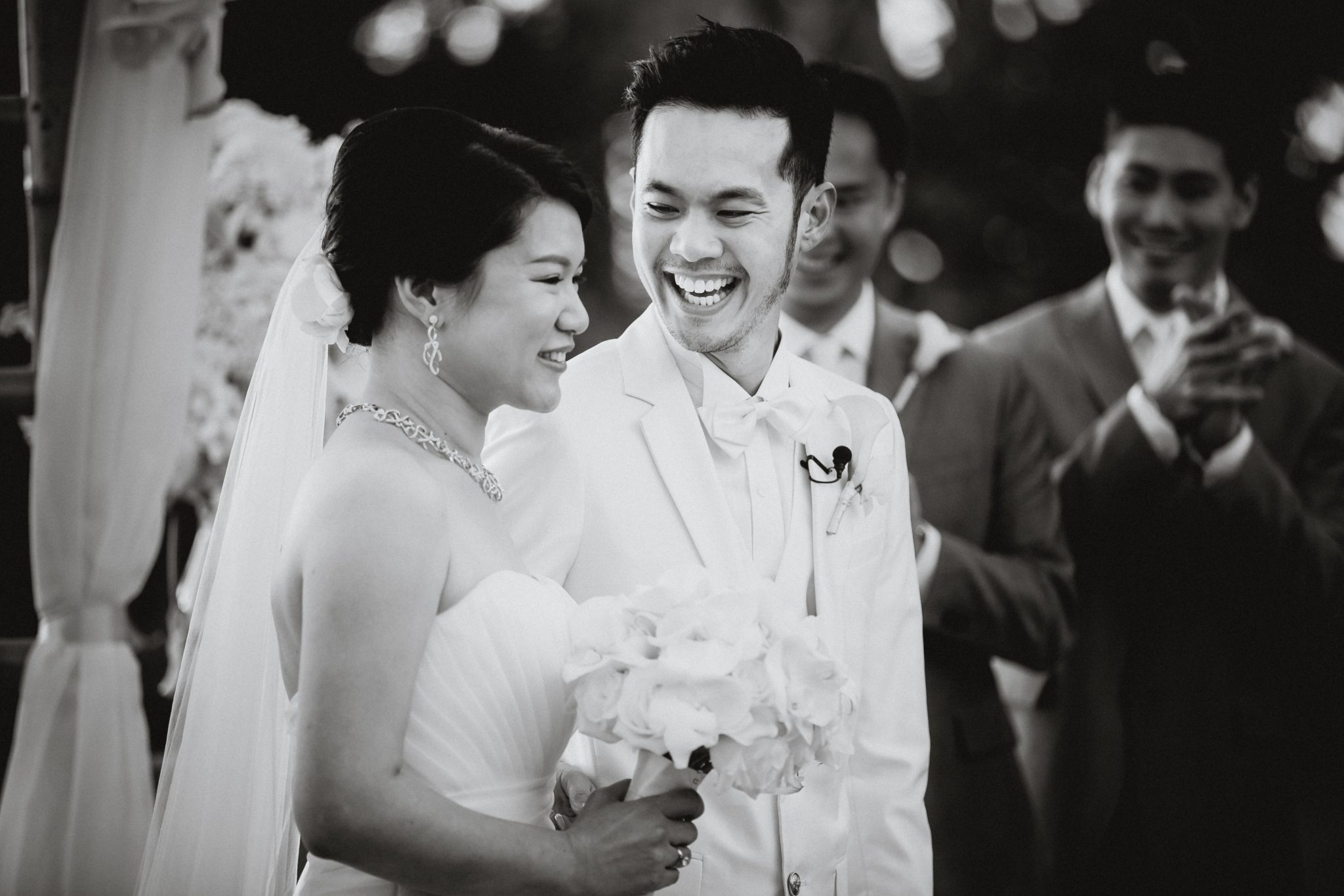 Groom smiles and laughs during the ceremony