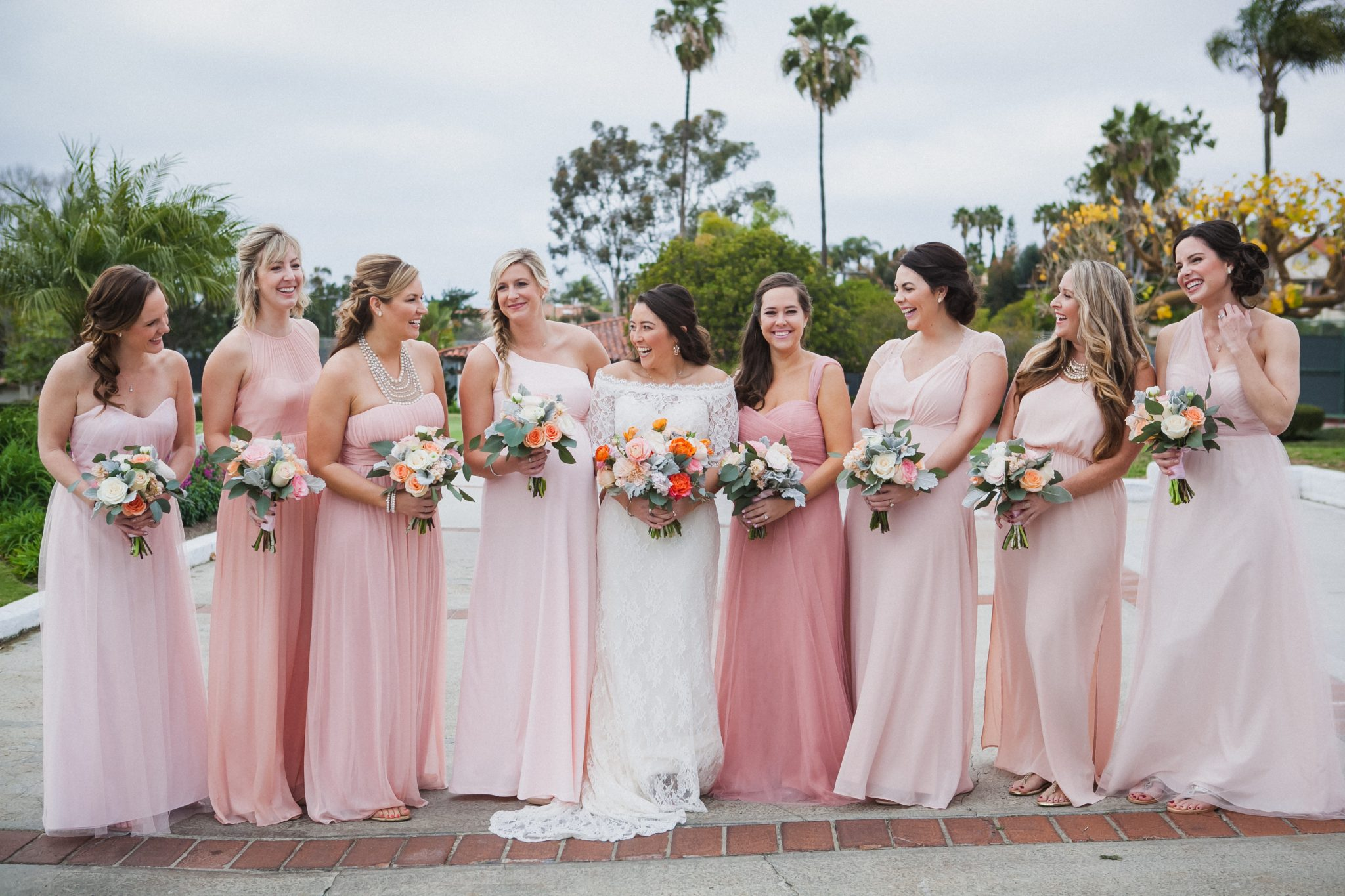 Portrait of the bride and bridesmaids wearing pink dresses