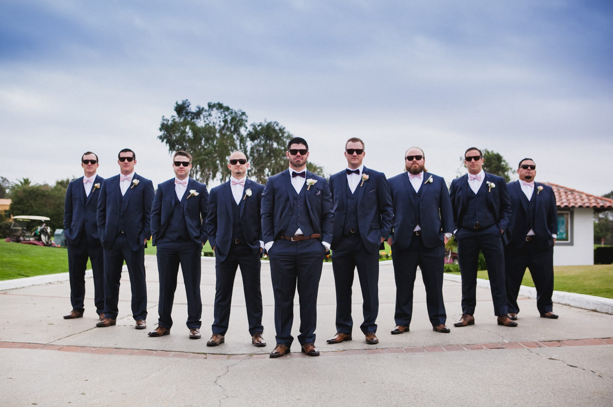Groom and groomsmen wearing Men's Warehouse suits and sunglasses