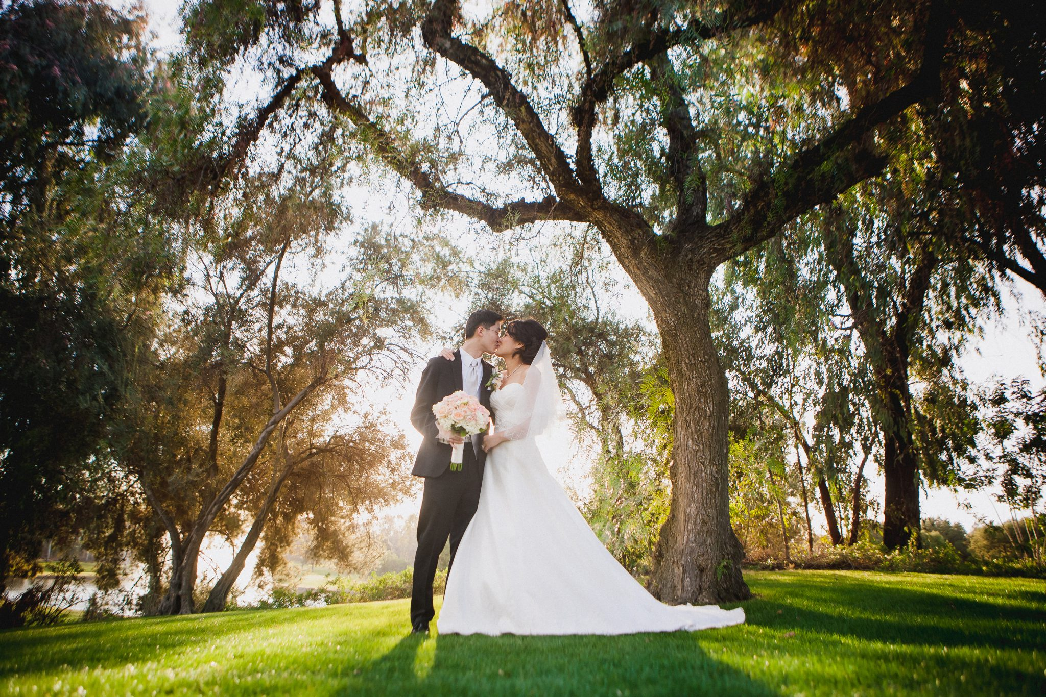Wide angle portrait of the couple during golden hour