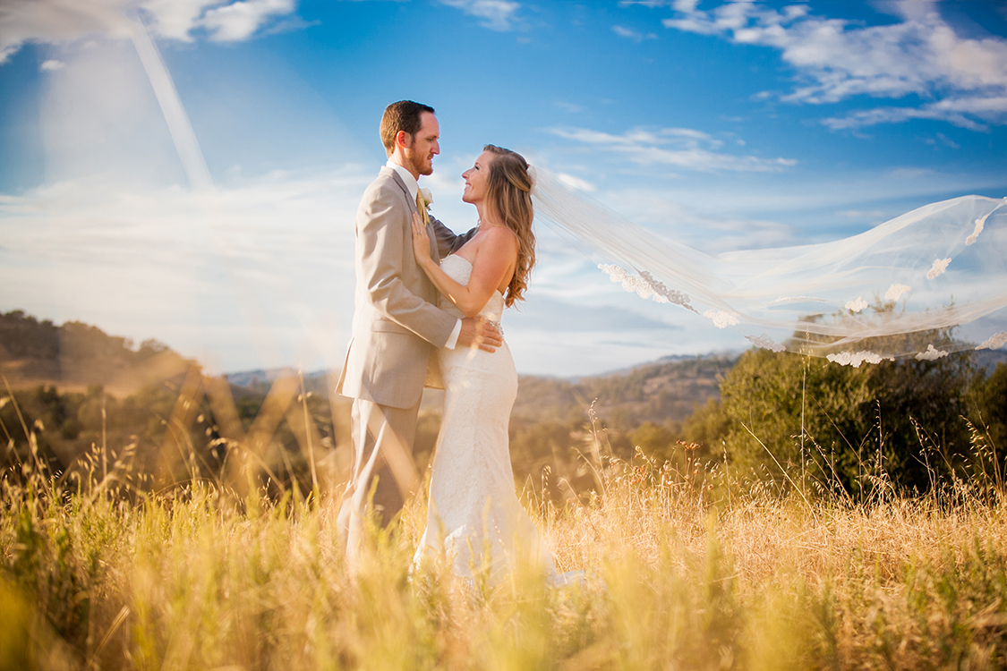Couple standing together in a field in Julian