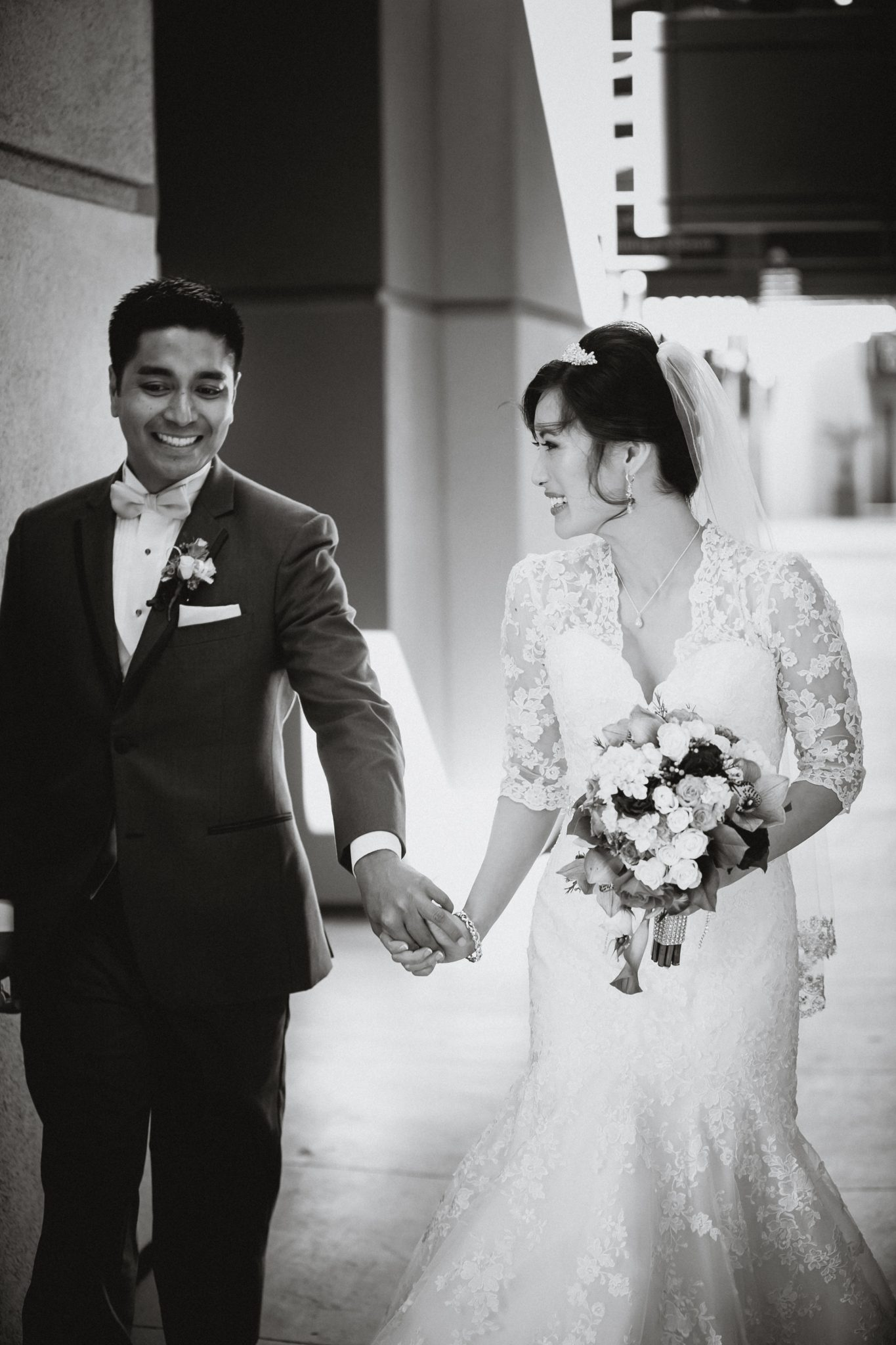 Candid black and white image of the couple walking