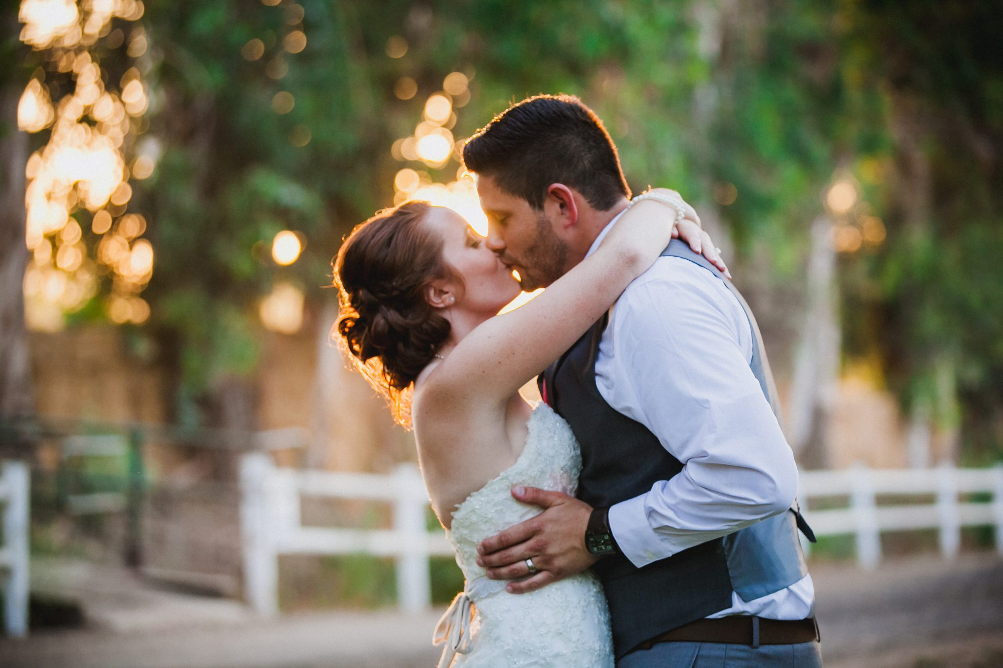 Couple kissing during golden hour on their wedding day