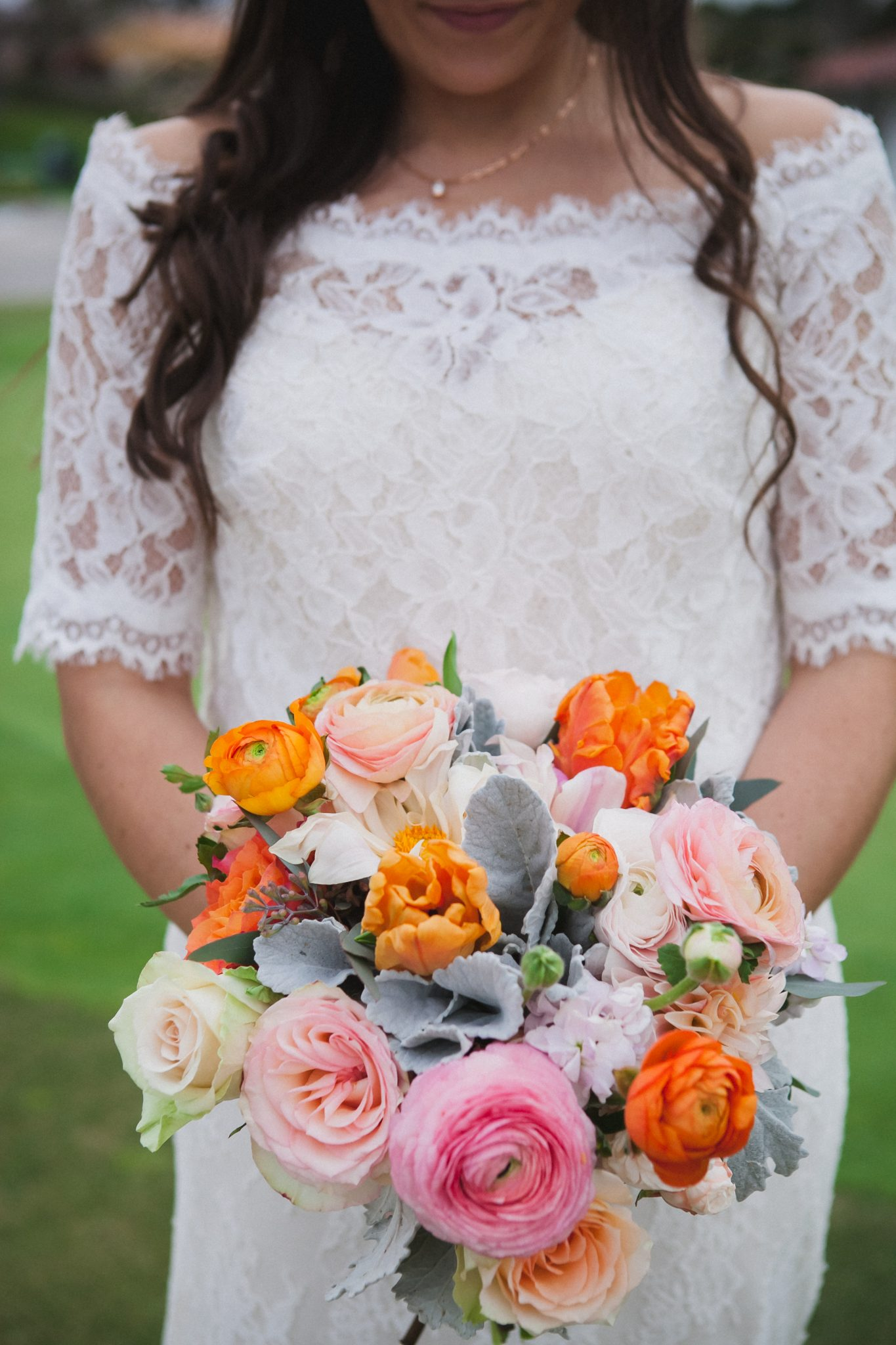 Detail shot of the bride's pink and orange flowers
