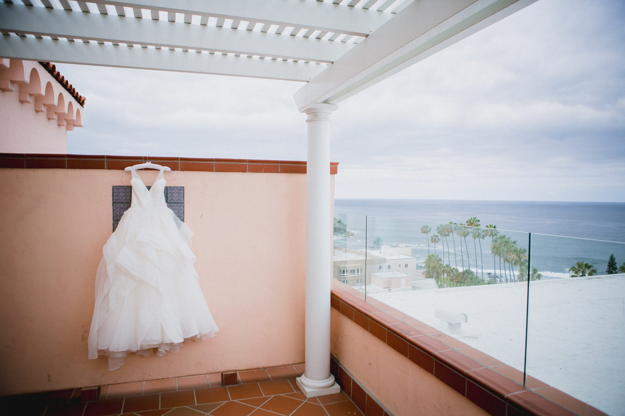 Wedding Dress hanging outside at La Valencia with ocean in background