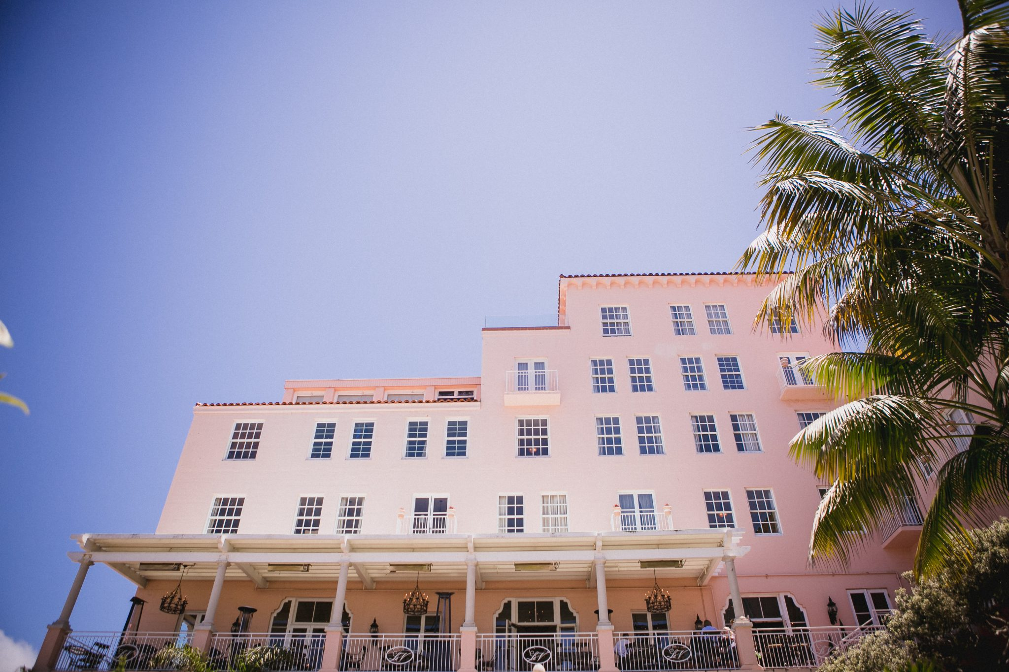 La Valencia Hotel's pink building by palm trees