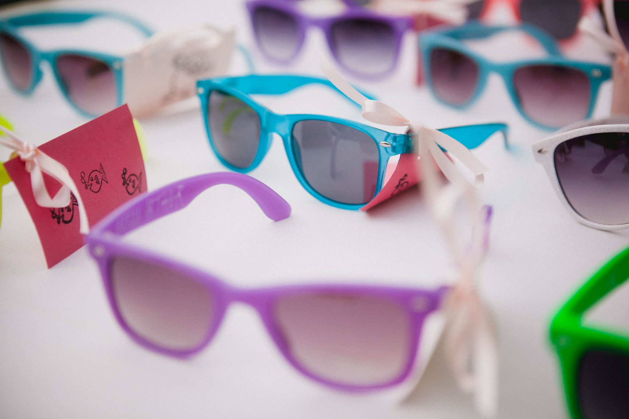 Sunglasses wedding favors for guests during the ceremony
