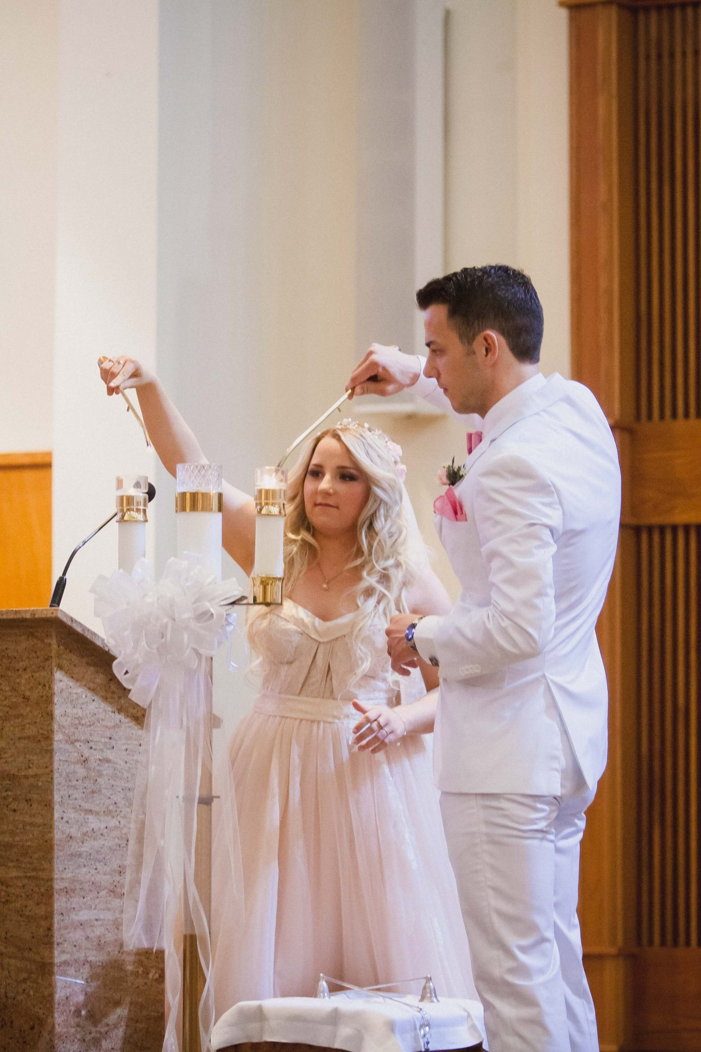 Bride and groom light the unity candle at St. Clare's Catholic Church