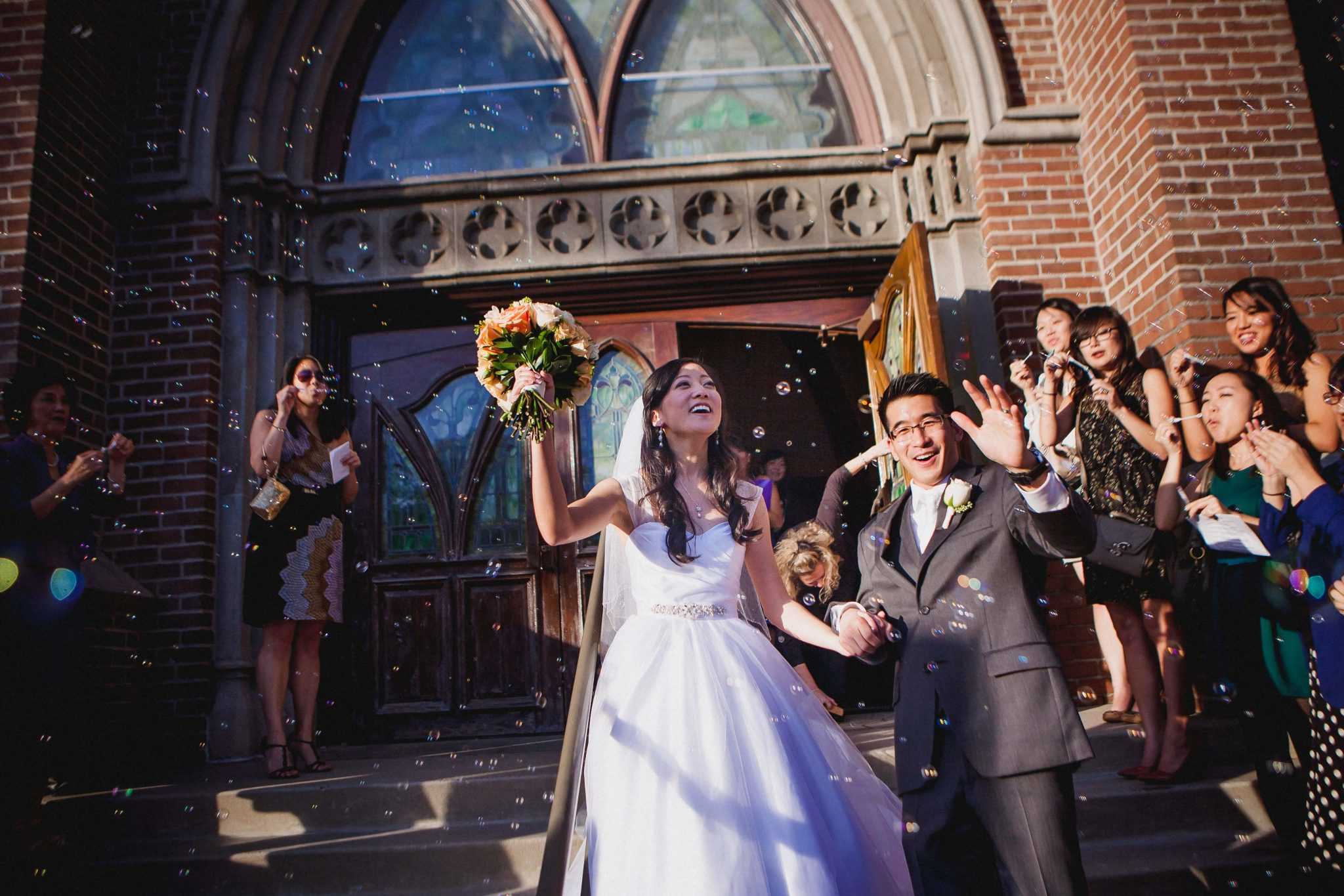 Bride and Groom walk through bubbles at the end of the wedding ceremony