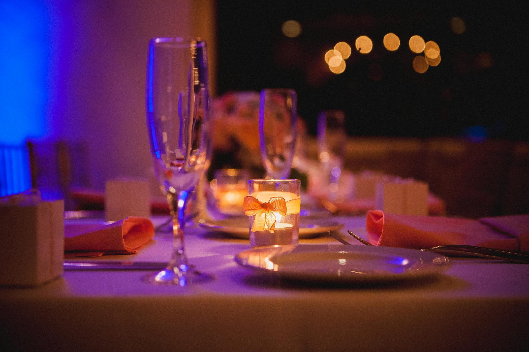 Candle on top of wedding reception table as part of the wedding decor