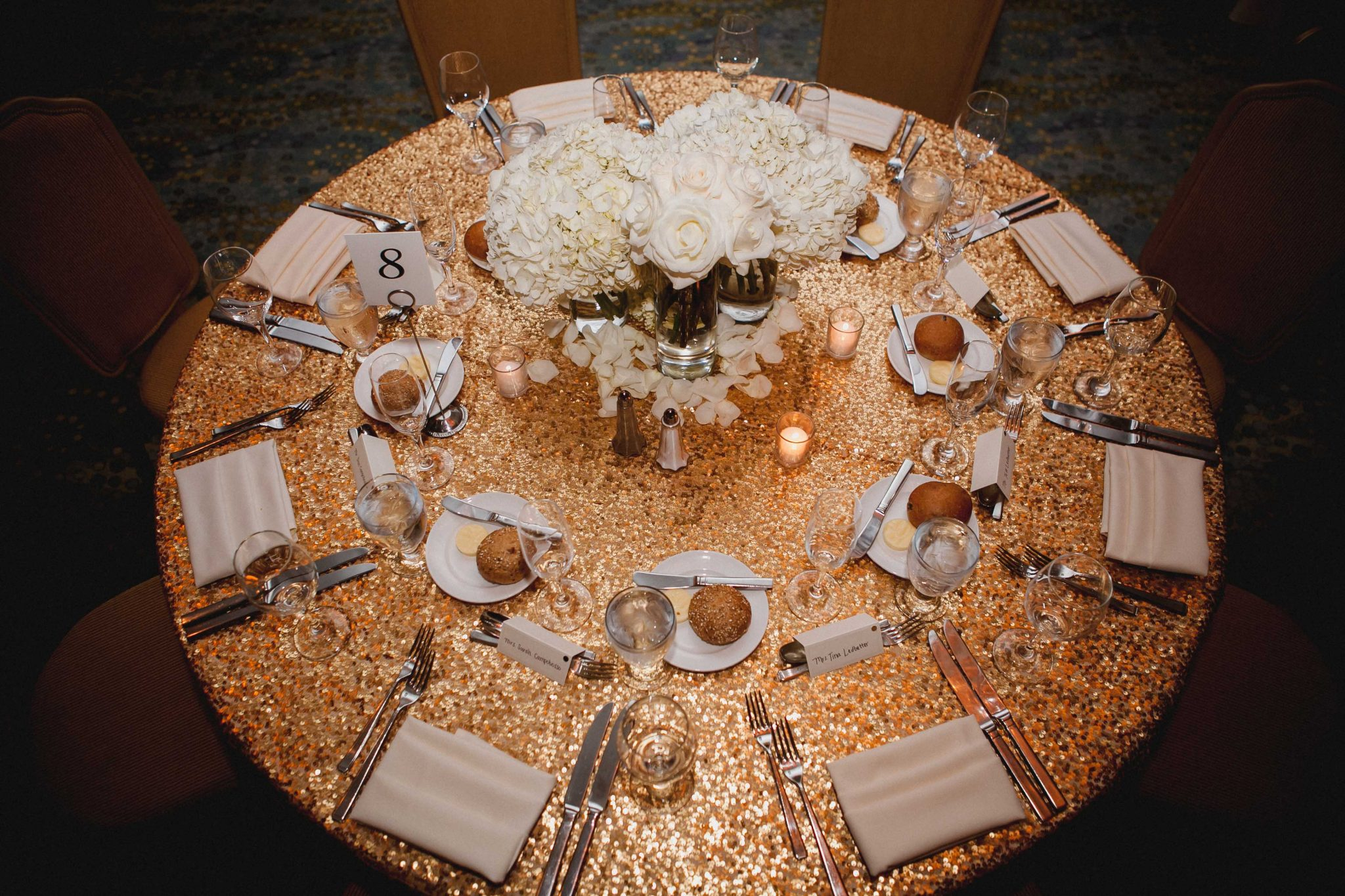 Gold sequin table linens at wedding reception at Loews Hotel in San Diego