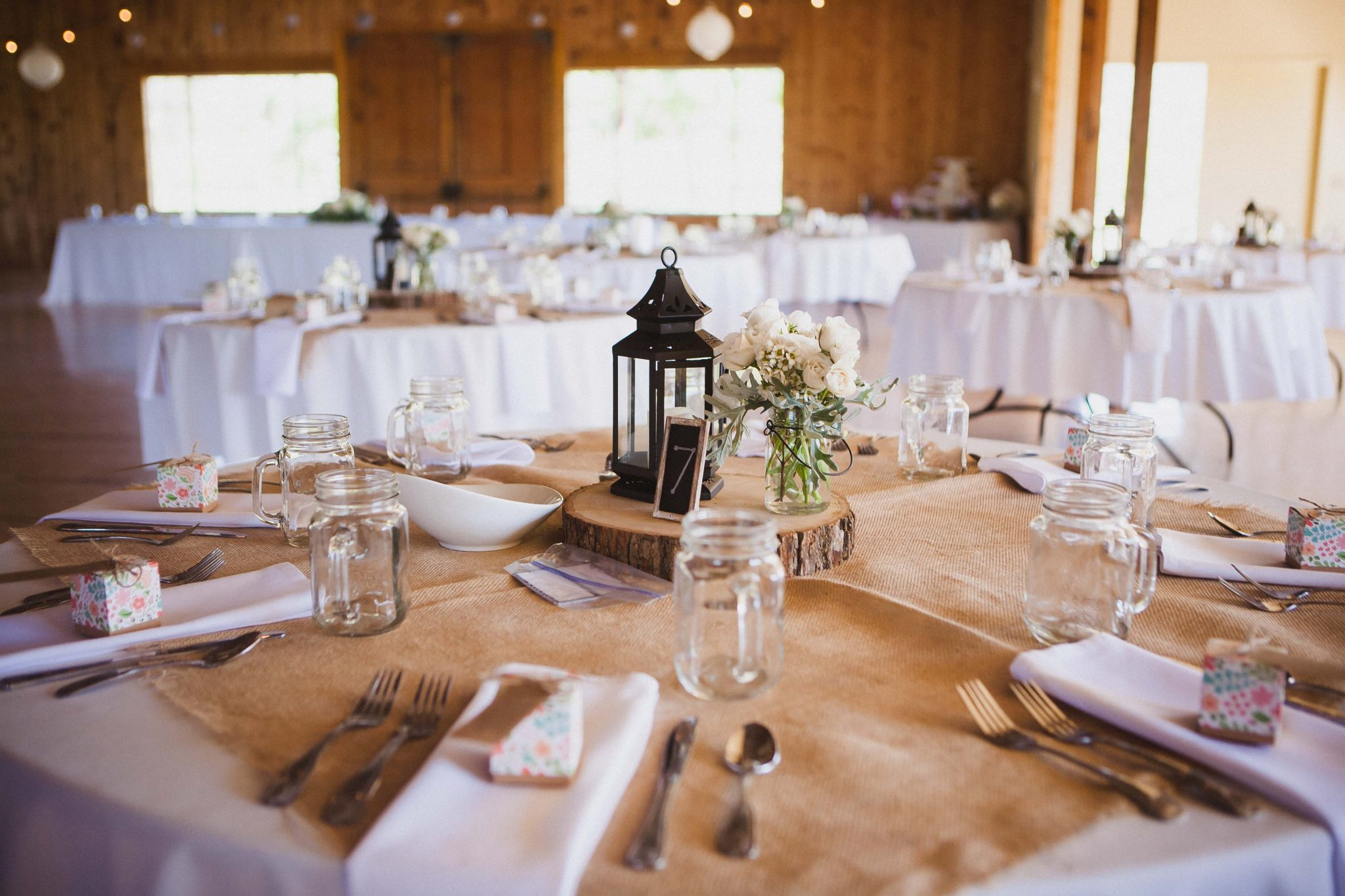 Burlap table runner detail on the tables at a wedding reception