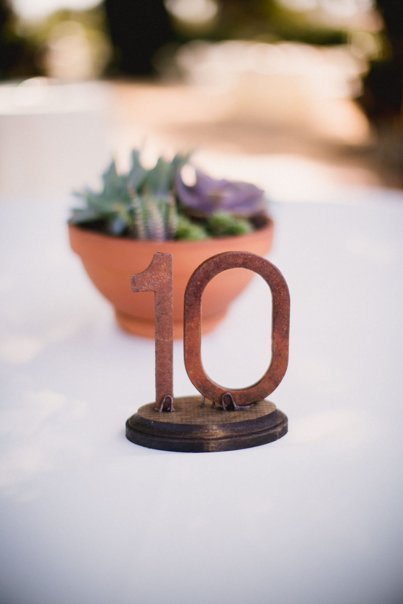 Table number decor made of terra cotta for a wedding reception