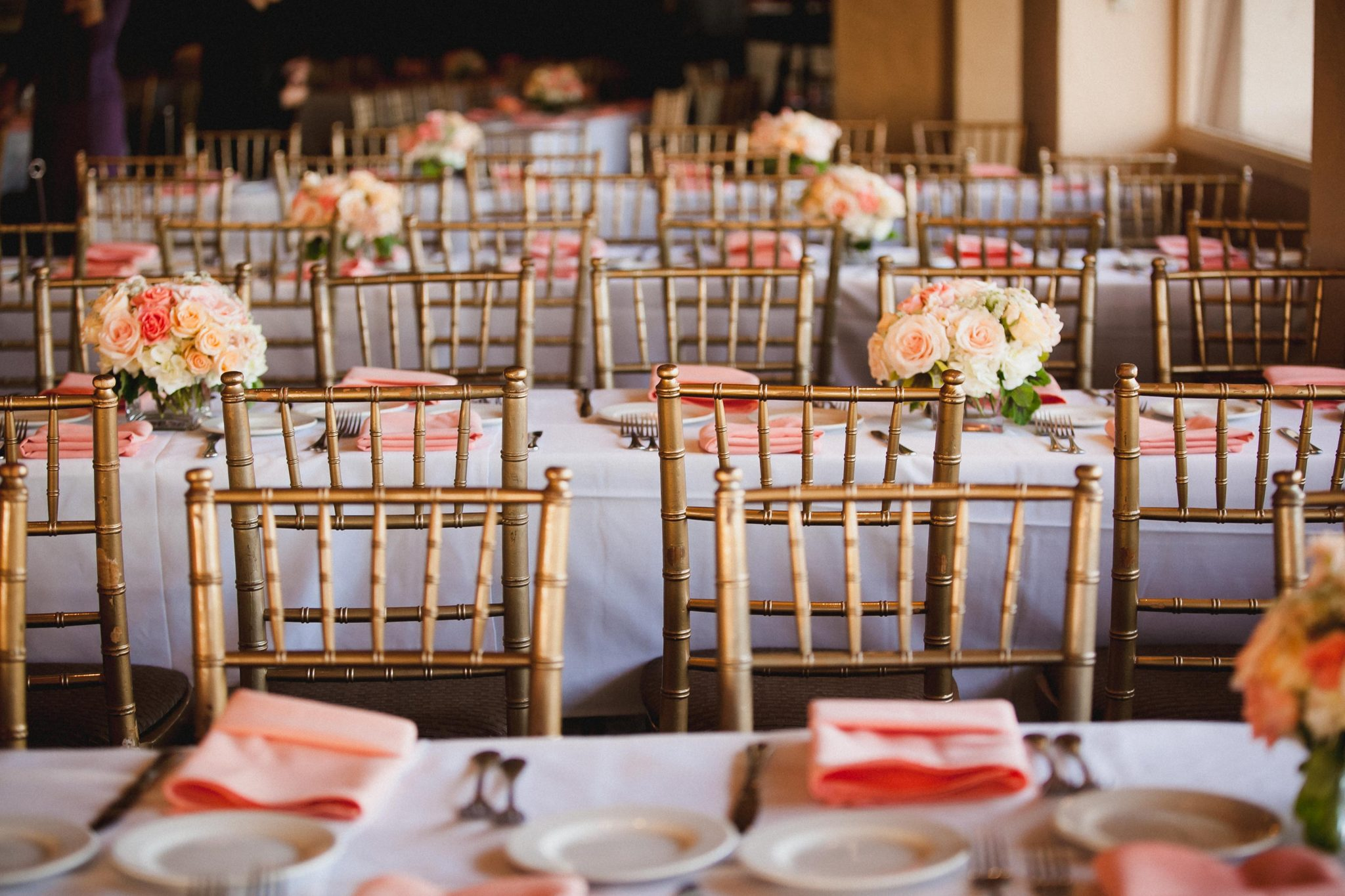 Gold chairs for guests to sit on at a wedding reception at Tom Ham's Lighthouse