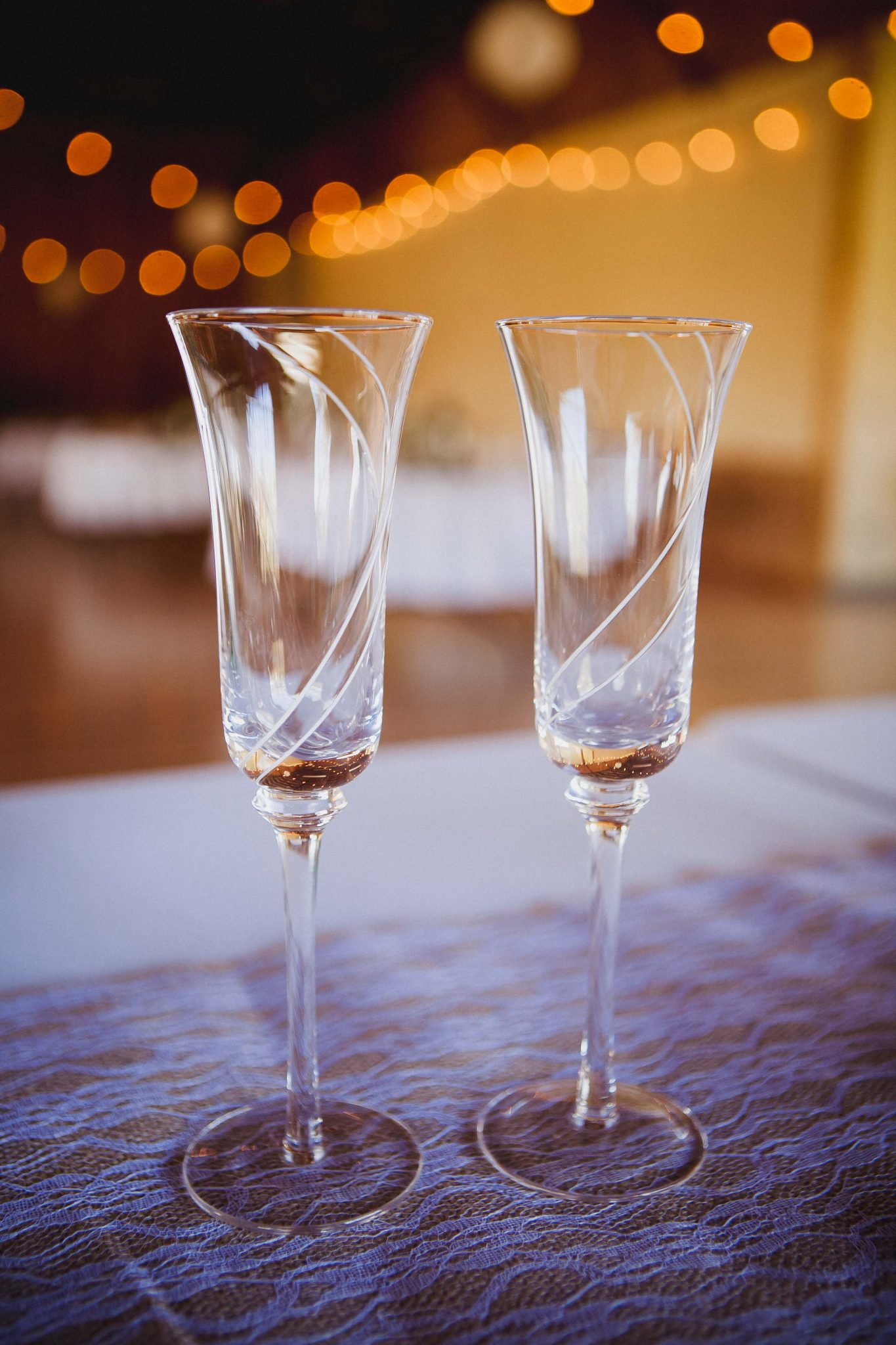 Glass champagne flutes for the bride and groom to use during wedding toasts