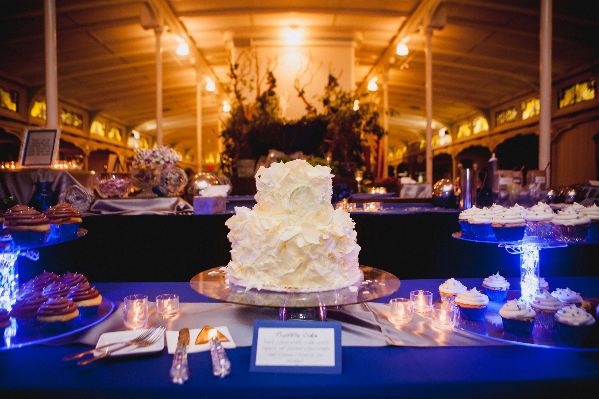 Wedding cake and dessert table with cupcakes during the reception