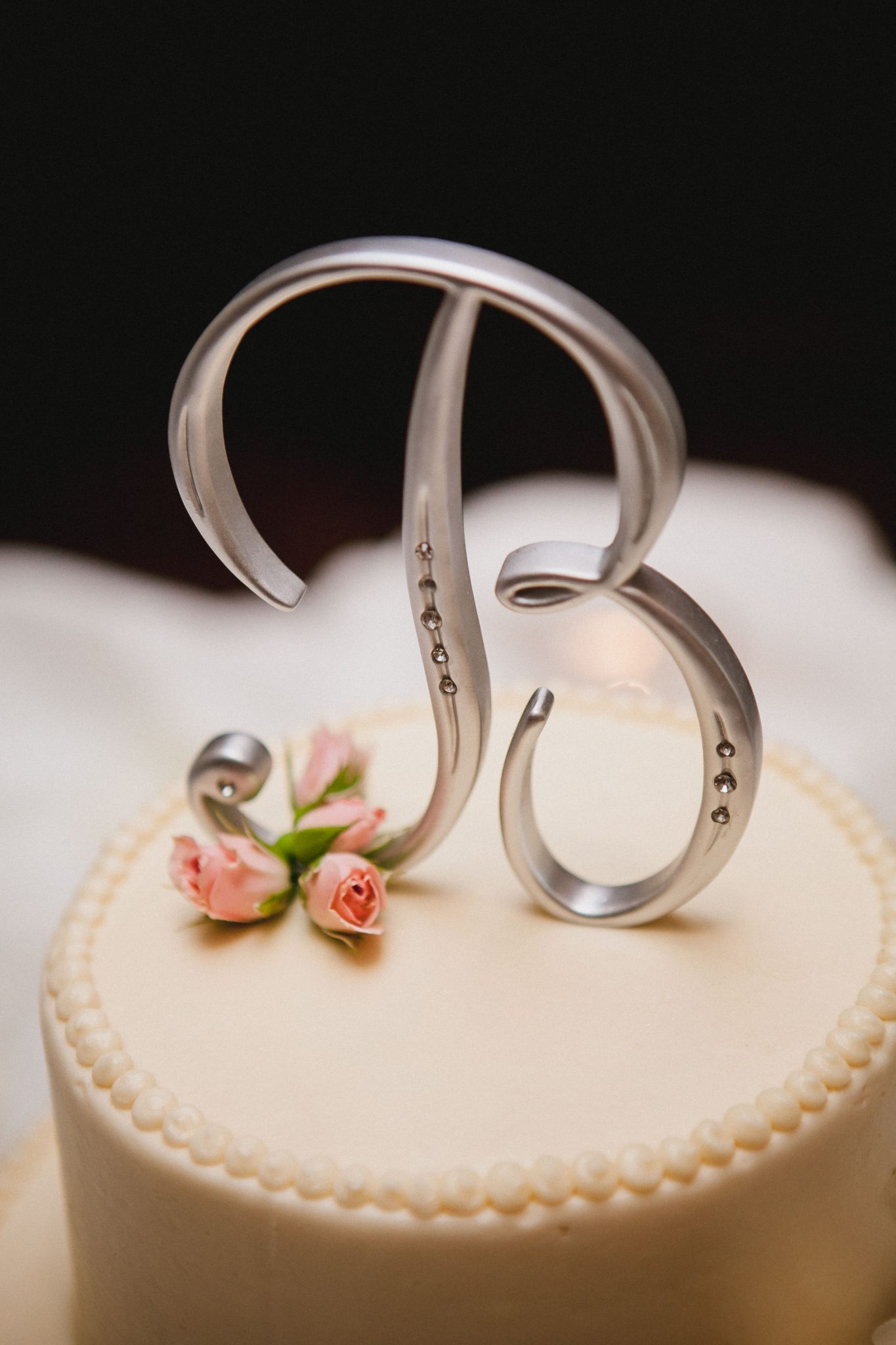Wedding cake topper with the letter B in silver