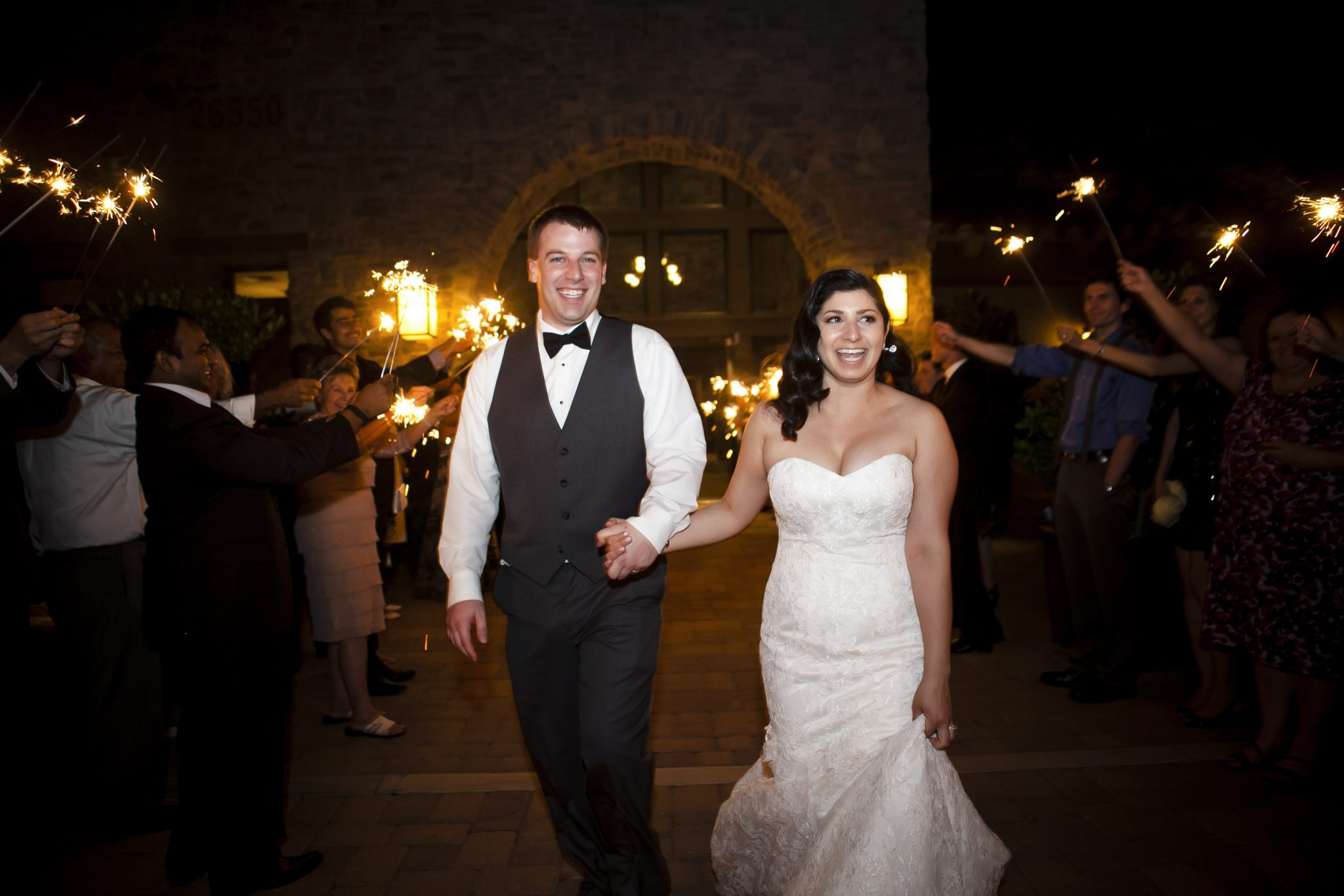 Bride and groom walking under a sparkler exit at the Tournament Player's Club in Santa Clarita
