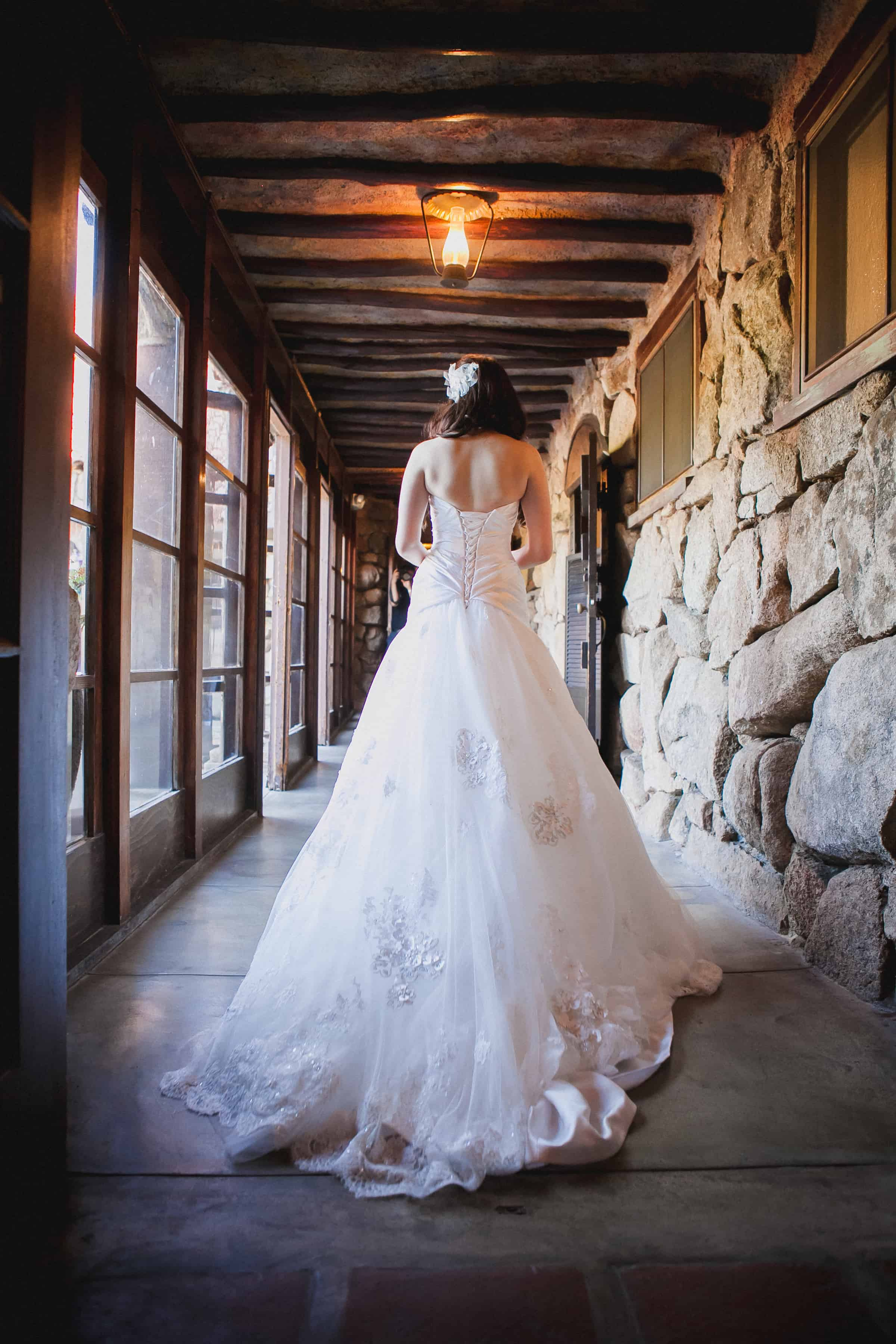 Bride in a white tulle wedding dress waiting to walk to the groom during the first look