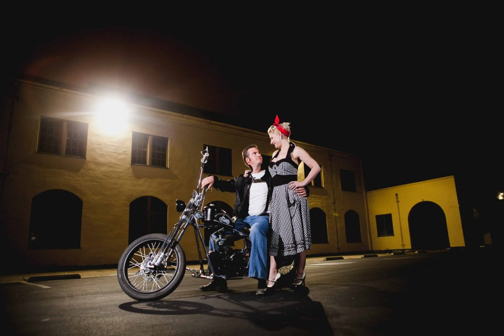 Couple sitting on a motorcycle for their engagement photos